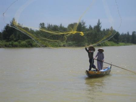 Fisker på Hoi An river